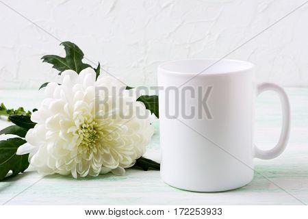 White coffee mug mockup with chrysanthemum. Empty mug mock up for design presentation.