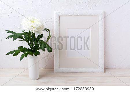 White frame mockup with chrysanthemum in vase. Empty frame mock up for presentation design.