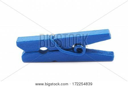 Single blue painted wooden clothespin isolated over the white background