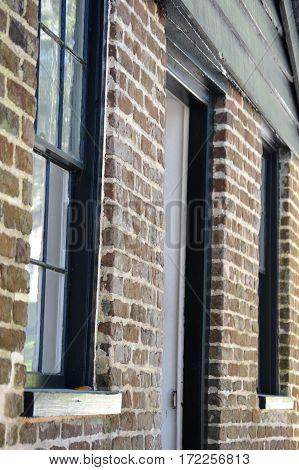 colonial brick exterior shot of windows and doorway