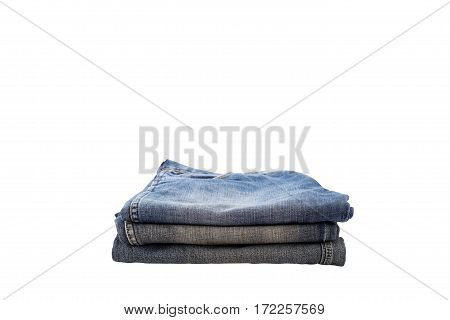 pile of clothesstack of blue jeans isolated on white background