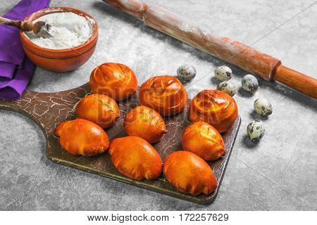 Preparing patties buns bread. Ingredients for cooking homemade patties buns bread wheat flour in bowl quail eggs wooden rolling pin. Fresh patties buns in board on gray concrete background.