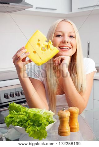 happy young beautiful woman eating cheese at home