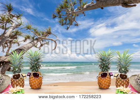 pineapple with sunglasses and hat beach on woodconcept summer background