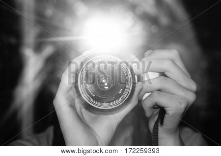 Picture of someone taking a picture with flash