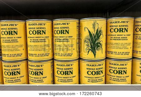New York Februrary 14 2017: Cans of whole kernel corn are stacked on a shelf in a Trader Joe's store.