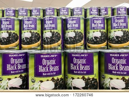 New York Februrary 14 2017: Cans of Organic Black Beans are stacked on a shelf in a Trader Joe's store.