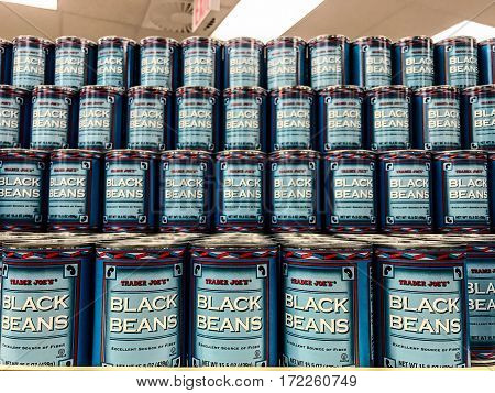New York Februrary 14 2017: Cans of Black Beans are stacked on a shelf in a Trader Joe's store.