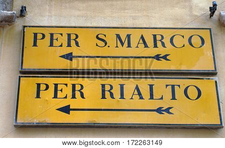 Directional signage for piers in Venice Italy