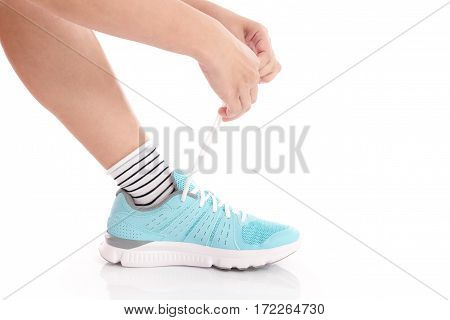 woman tying shoelaces on white background isolated