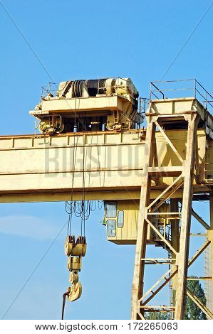 Full gantry crane over blue sky background