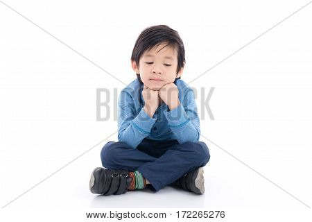 Asian child is getting bored on white background isolated