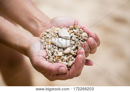 Woman Palms Holding Pebble
