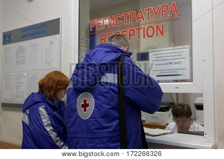 ST. PETERSBURG, RUSSIA - JANUARY 30, 2017: Ambulance crew brought the patient to I.I. Dzhanelidze Research Institute of Emergency Medicine. The institute celebrates its 85th anniversary on February 1