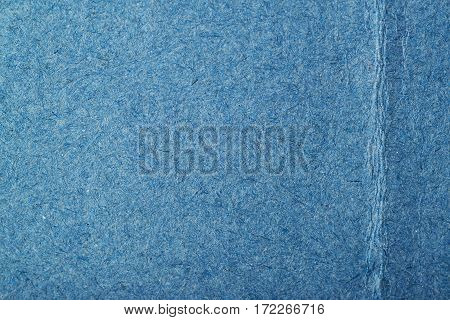 Fragment of a recycled blue cardboard paper texture