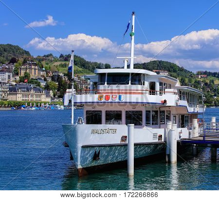 Lucerne, Switzerland - 8 May, 2016: MS Waldstatter at a pier on Lake Lucerne. Lake Lucerne is a lake in central Switzerland, it is the fourth largest lake in the country.