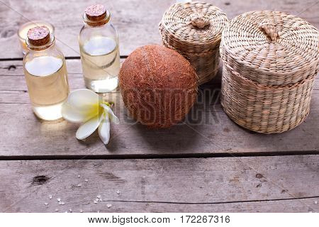 Bottles with coconut oil on vintage wooden background. Selective focus. Place for text.