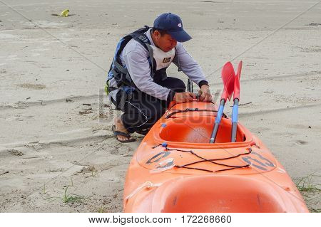 Labuan,Malaysia-Feb 19,2017:Adventurer man ready to kayaking in Labuan island,Malaysia.Malaysia is the ideal place for water sports,like white water rafting,kayaking,scuba diving & sailing