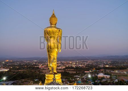 behind Buddha statue before sunset time at Wat Phra That Kao Noi Nan Thailand