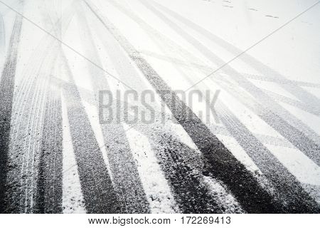 tire tracks on the street after snow