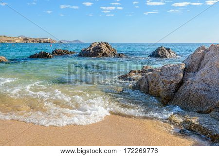 Playa el Chileno Beach, Cabo San Lucas, Mexico. Different stages of the fantastic ocean waves. Rocky and sandy beach.