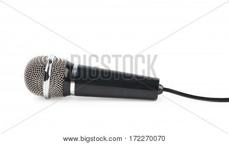 Black microphone with a cord isolated over the white background