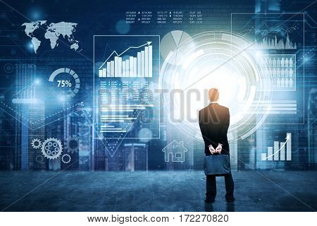 Rear view of businessman looking at financial graph icon on the virtual screen