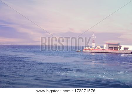 View From The Deck Of Cruise Ship On The Pier Of The Greece Island With Lighthouse. Greece. Toned Im