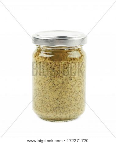 Glass jar of the green italian pesto isolated over the white background