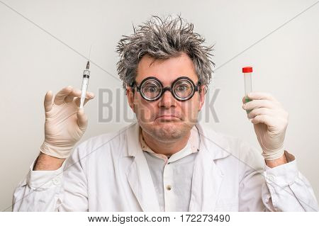 Crazy Scientist With Gray Hair Performing Experiments