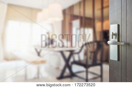 Opened Wooden Door To Modern Dining Room Interior.