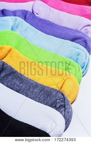different color socks textile background. Textile background