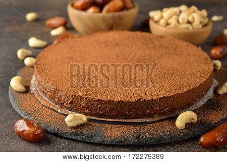 Raw vegan chocolate cake with cashew nuts and dates
