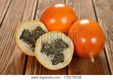 Exotic fruit granadilla on a brown background