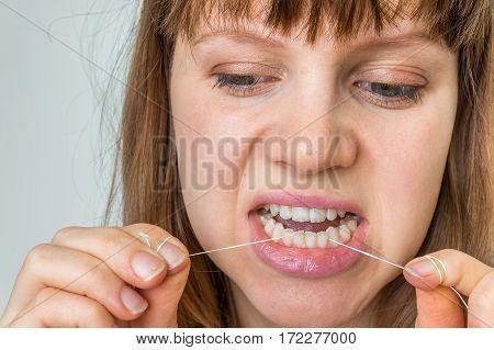 Woman Flossing Teeth With Dental Floss