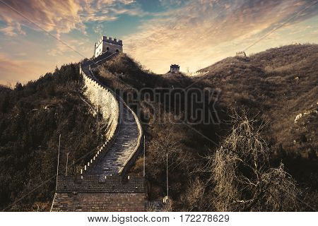 Great Wall of China with path and watchtower under sunset sky in Beijing China