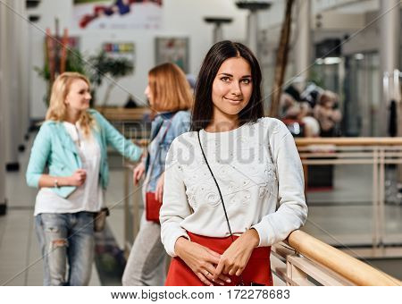 three pretty girls having fun while shopping - Best female friends spending time together. one woman portrait with two on background