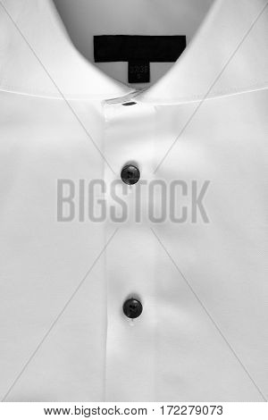 Close up of a white mens shirts.