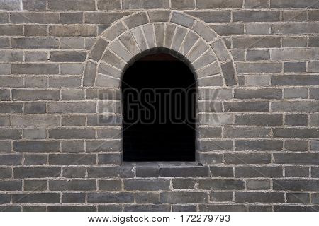 Image of a hole on the brick wall of the Great Wall in Beijing China