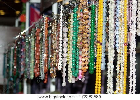 The counter with colorful beads and necklaces