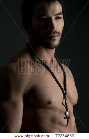 perfect nude body.Perfect naked male torso against black background