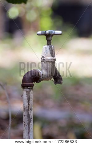 Water supply tap in the garden on a half inch pipe