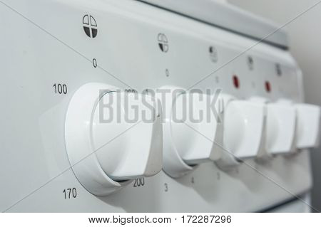 Close-up images of control panel of modern gas stove