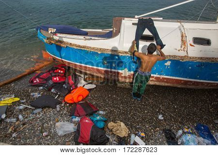 KOS ISLAND, GREECE - SEP 27, 2015: Unknown refugees arriving in Greece by inflatable boats from Turkey. Kos island is located just 4 kilometers from the Turkish coasts.