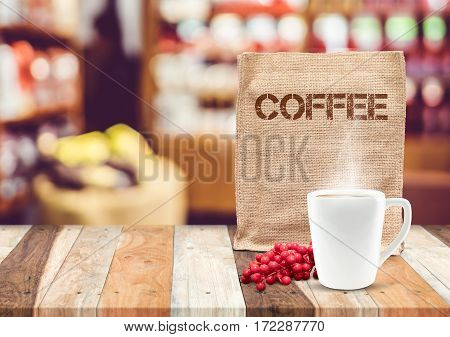 Coffee Sack Bag With Coffee Cup And Smoke With Blur Cafe Background,mock Up For Adding Your Text