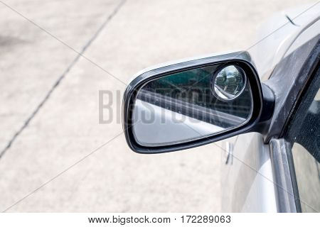 Close Up Wing Mirror Of Car At Outdoor Parking