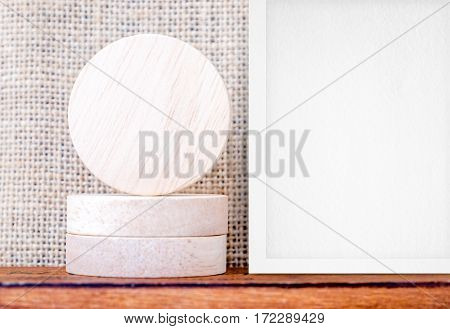 Blank Piece Of Round Wood And White Photo Frame On Wood Table And Sack Fabric Wall,mock Up For Displ