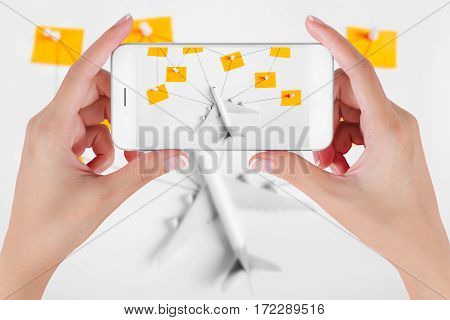 Woman hand using smart phone taking photo for preparation traveling network with push pin string and paper noted. Travel concepts Ambient blurry background.