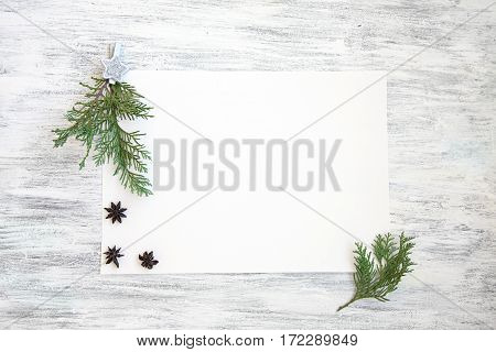 Winter flat lay template background with blank sheet and pine branches