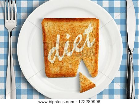Diet concept closeup of Table setting with fried slice of bread